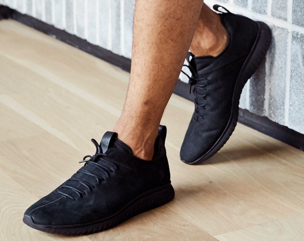 man wearing a black pair of sneakers