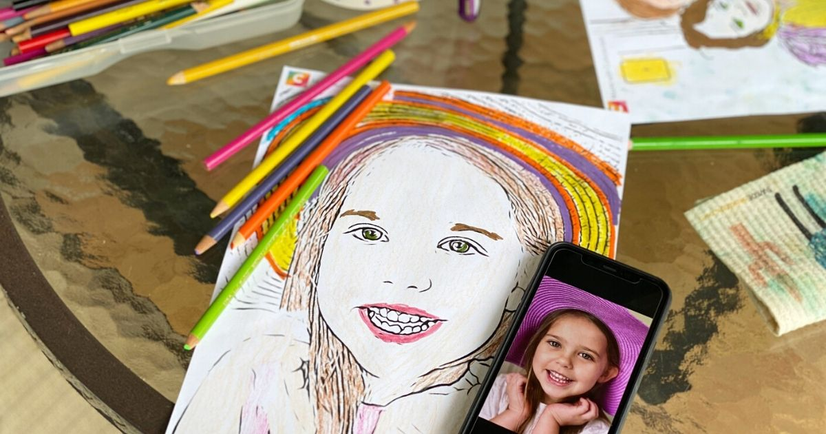 A Colorscape page made from the Colorscape app next to colored pencils on a table