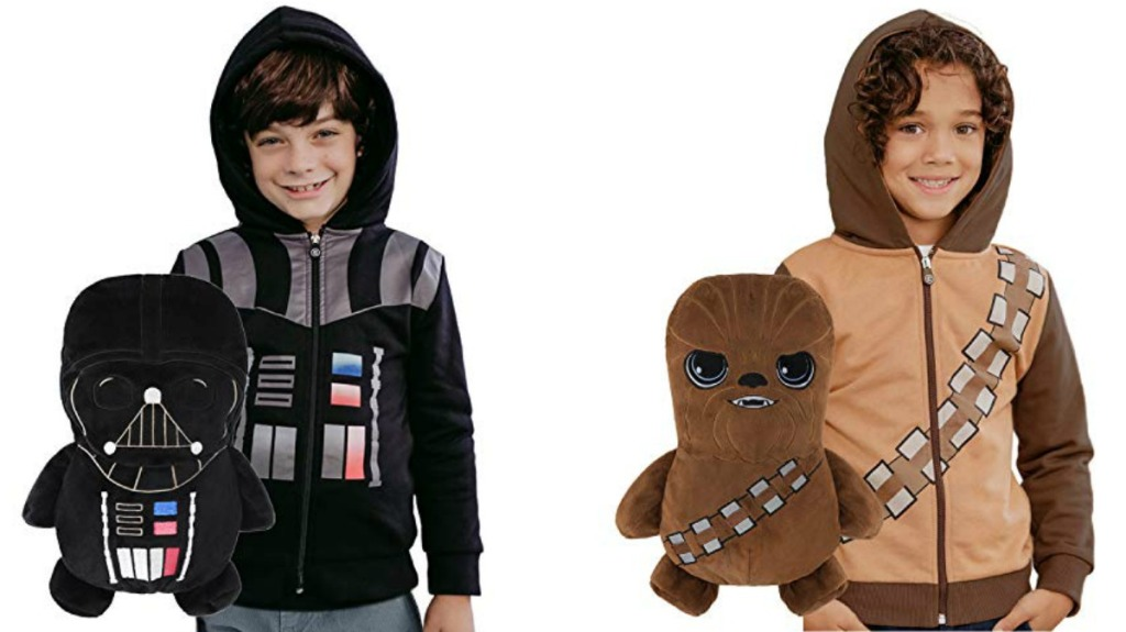 Two boys wearing Star Wars themed hoodies, holding matching plush toys