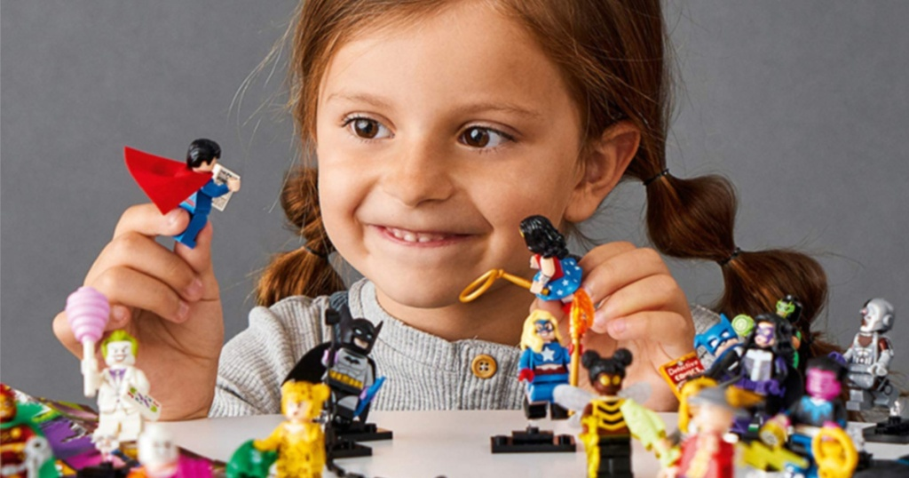 DC LEGO minifigures with little girl playing