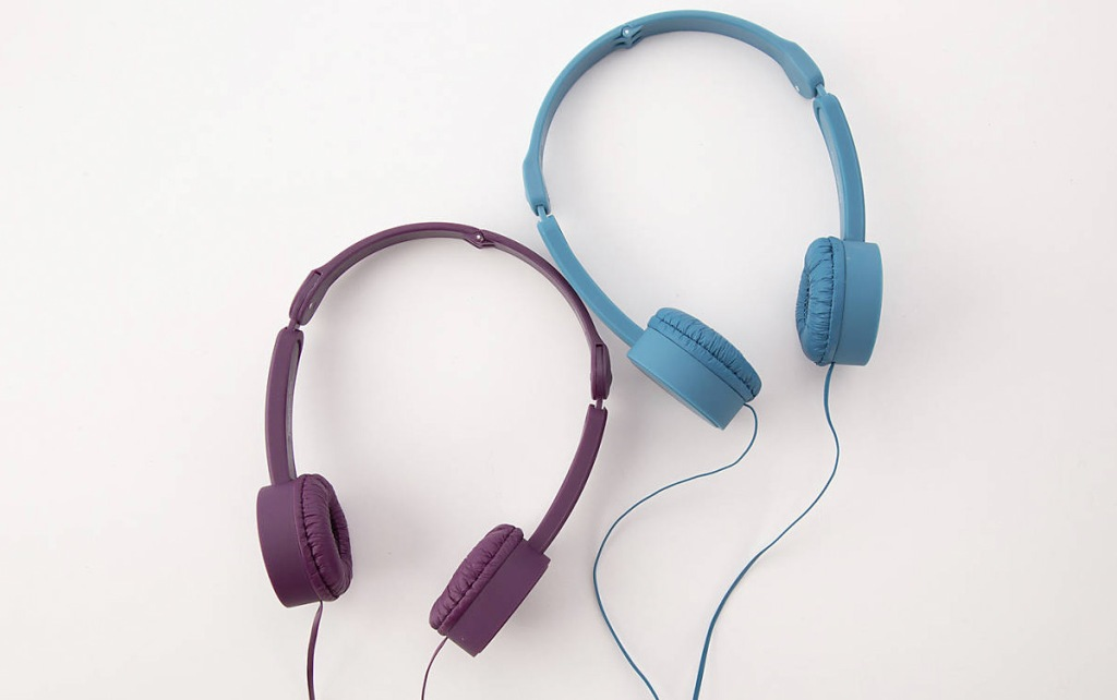 two pairs of kids headphones in purple and blue colors