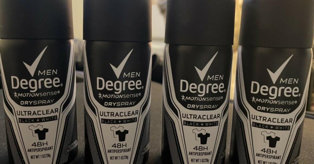four small men's dry deodorant sprays