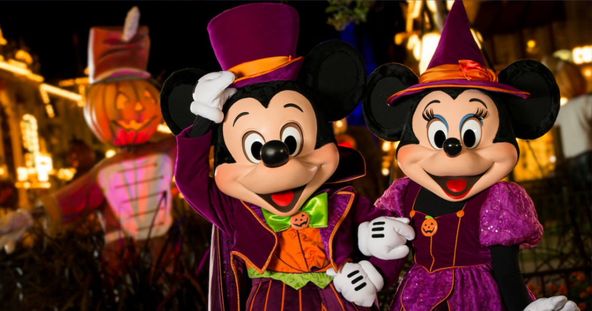 mickey and minnie mouse in halloween attire at disney