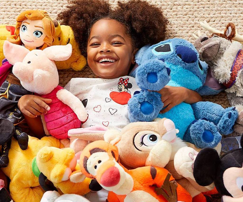 girl surrounded by stuffed animals