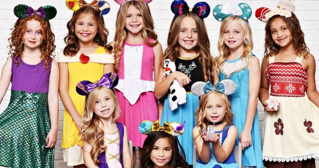 girls wearing princess dresses