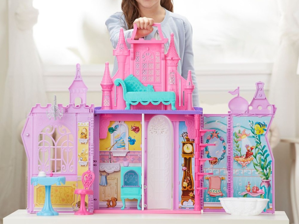 girl playing with large doll palace
