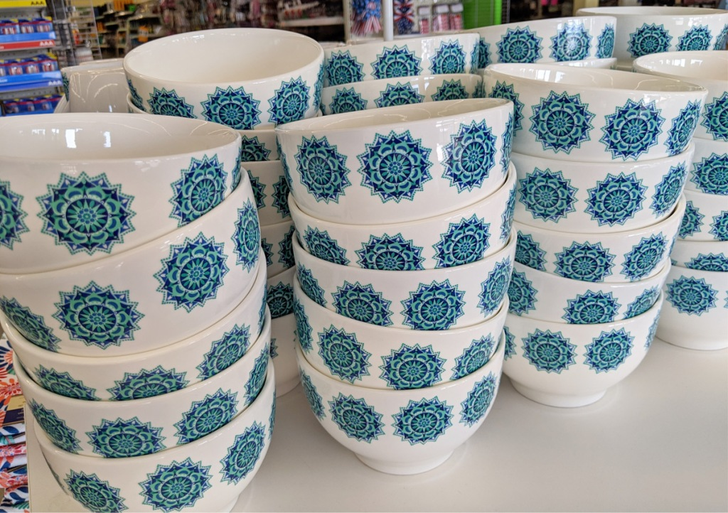 store display with blue and turquoise mediterranean themed bowls
