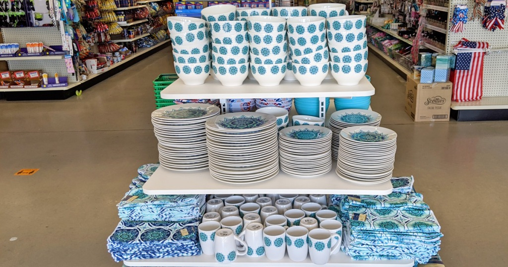store display with blue and turquoise mediterranean themed dinnerware with plates, mugs, and bowls