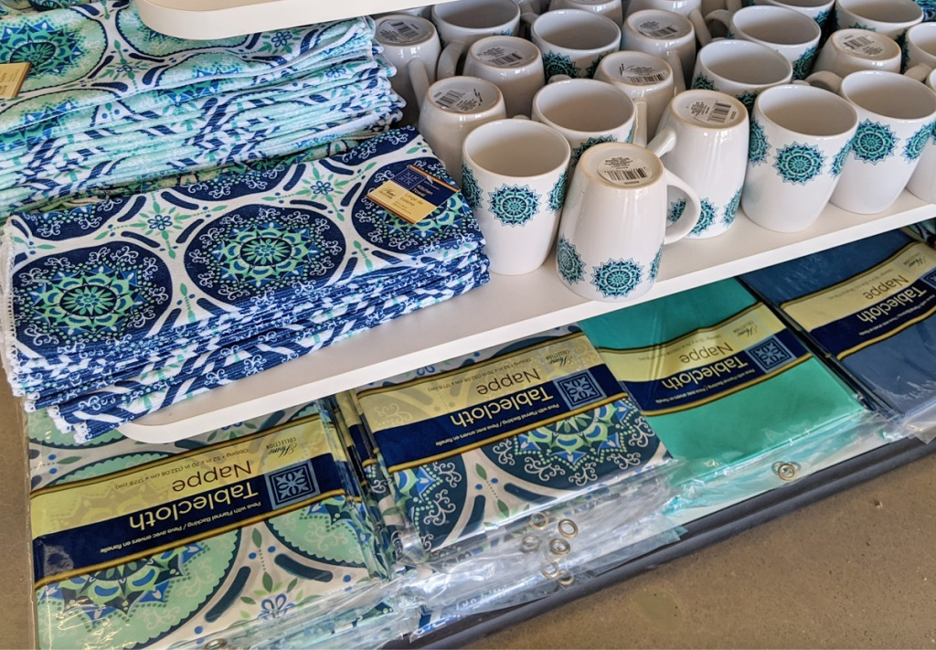 store display with blue and turquoise mediterranean themed coffee mugs and table cloths