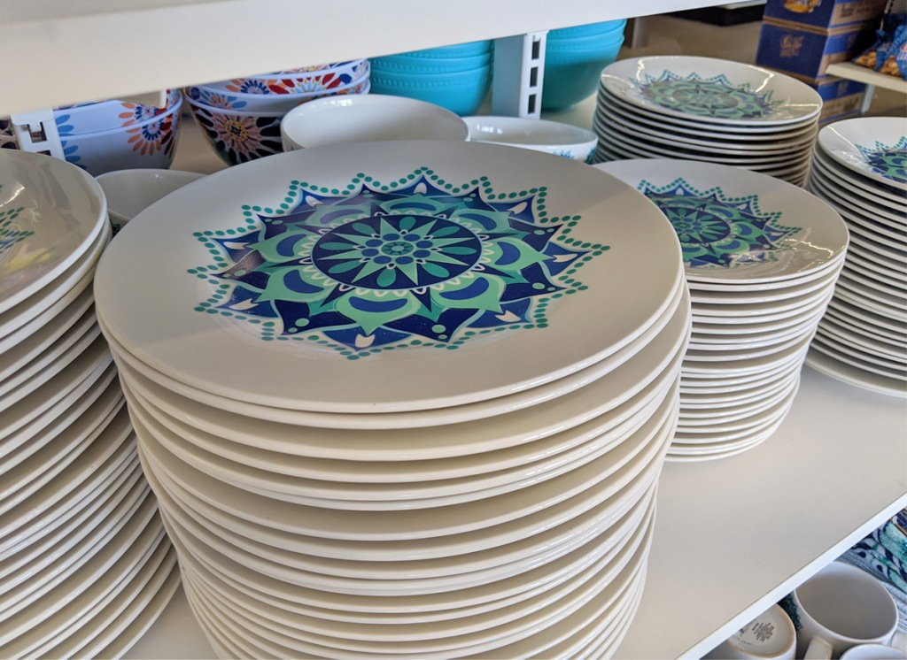 store display with blue and turquoise mediterranean themed dinner plates