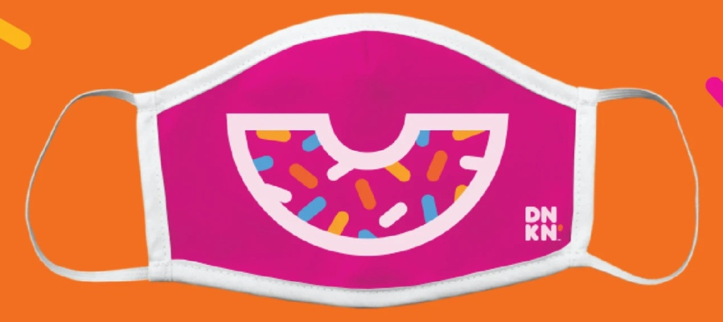 pink face mask with donut design and orange background