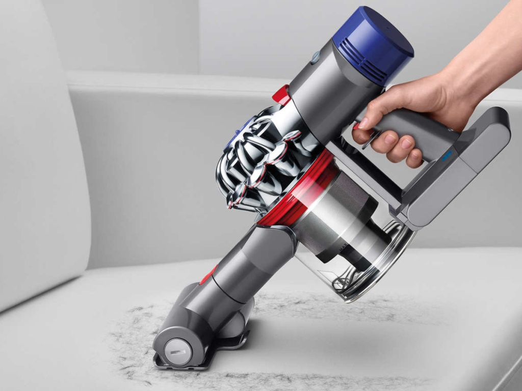 handheld vacuum attachment cleaning hair on couch