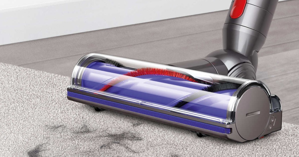 silver and purple vacuum cleaning hair on carpet