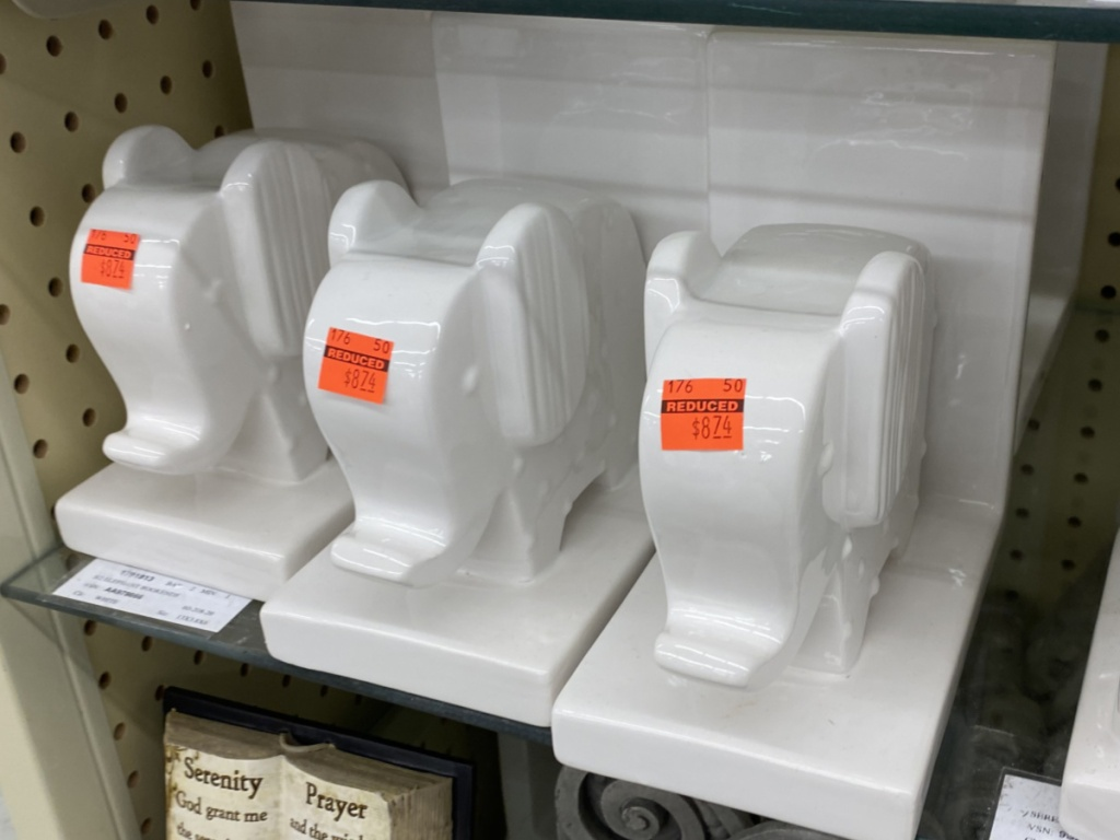 white elephant bookends on store shelf