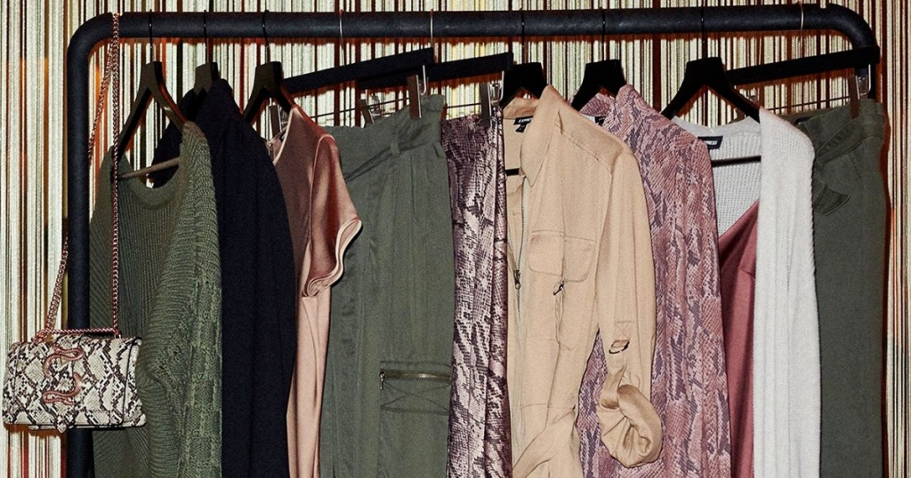 womens blouses and dresses hanging from a clothing rack