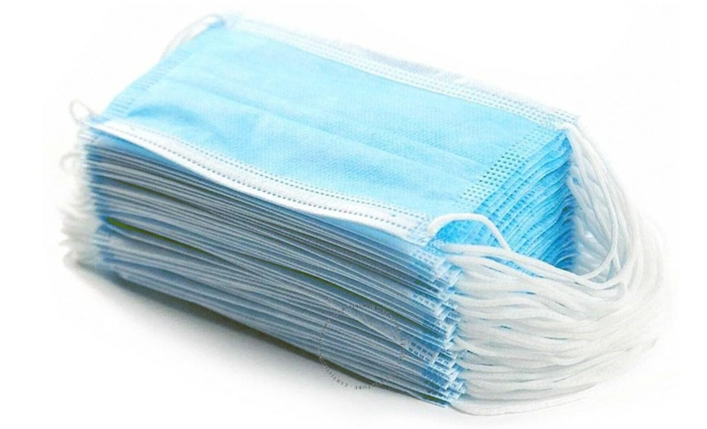 stack of blue face masks with white elastic ear loops