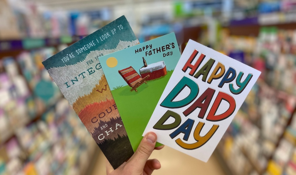 hand holding three Father's Day cards