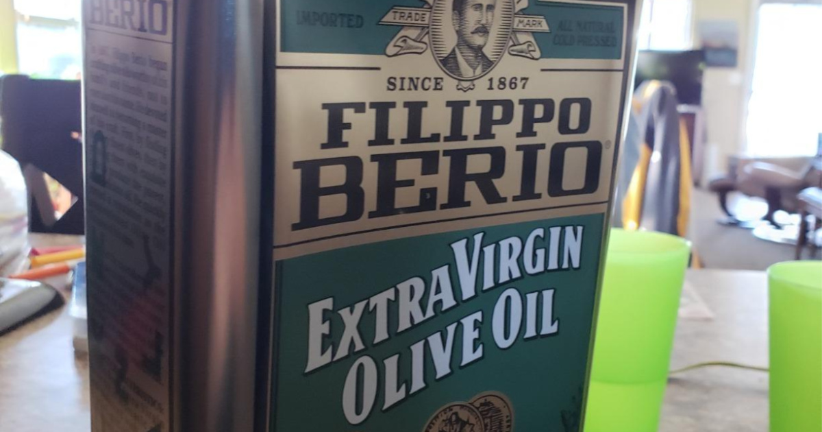 large tin of extra virgin olive oil in home