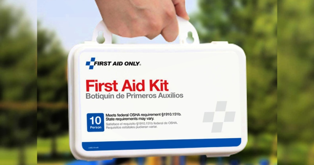 First Aid Only 57-Piece First Aid Kit in person's hand
