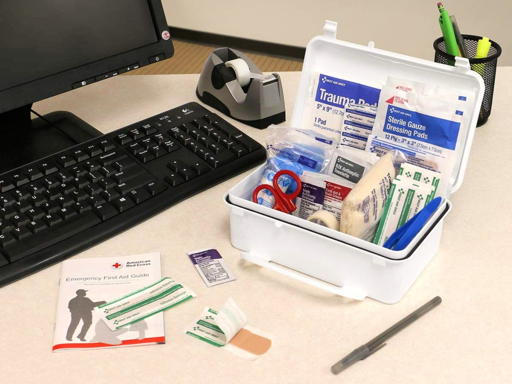 First Aid Only 57-Piece First Aid Kit with contents shown on desk