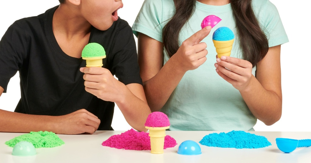 two kids playing with colorful foam ice cream kit
