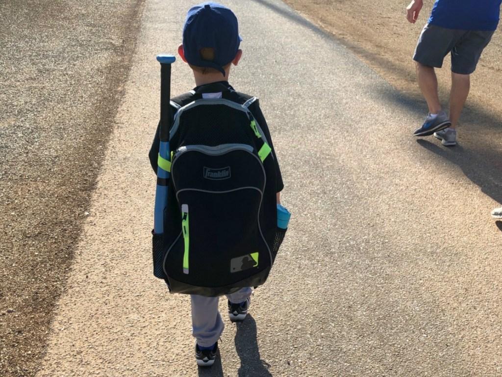 boy walking to baseball with a Frankin sports bag