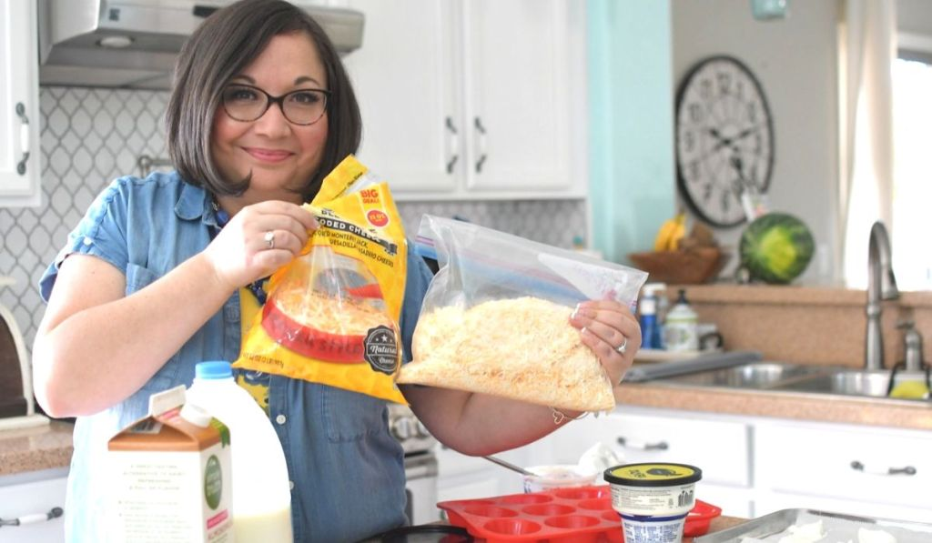 A woman holding a bag of shredded cheese in a freezer bag