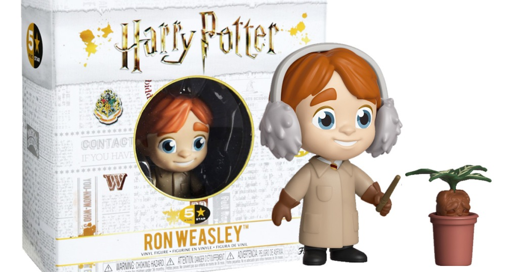 funko pop figurine of ron weasley from harry potter using wand on potted plant