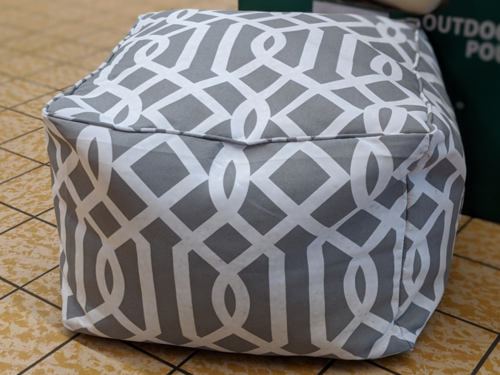 outdoor pouf with grey and white design on floor in store