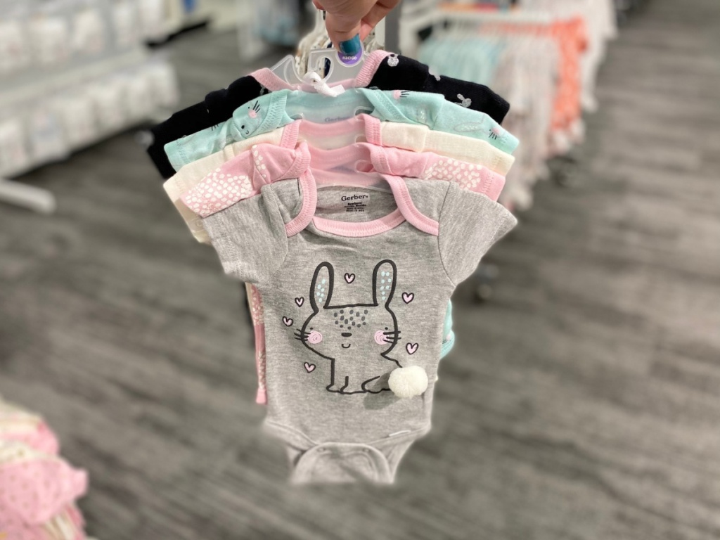 hand holding bunny bodysuits 5-pack