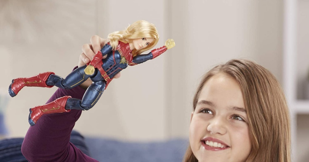 Girl playing with Marvel's Captain Marvel Photon Power FX Light-Up Action Figure by Hasbro