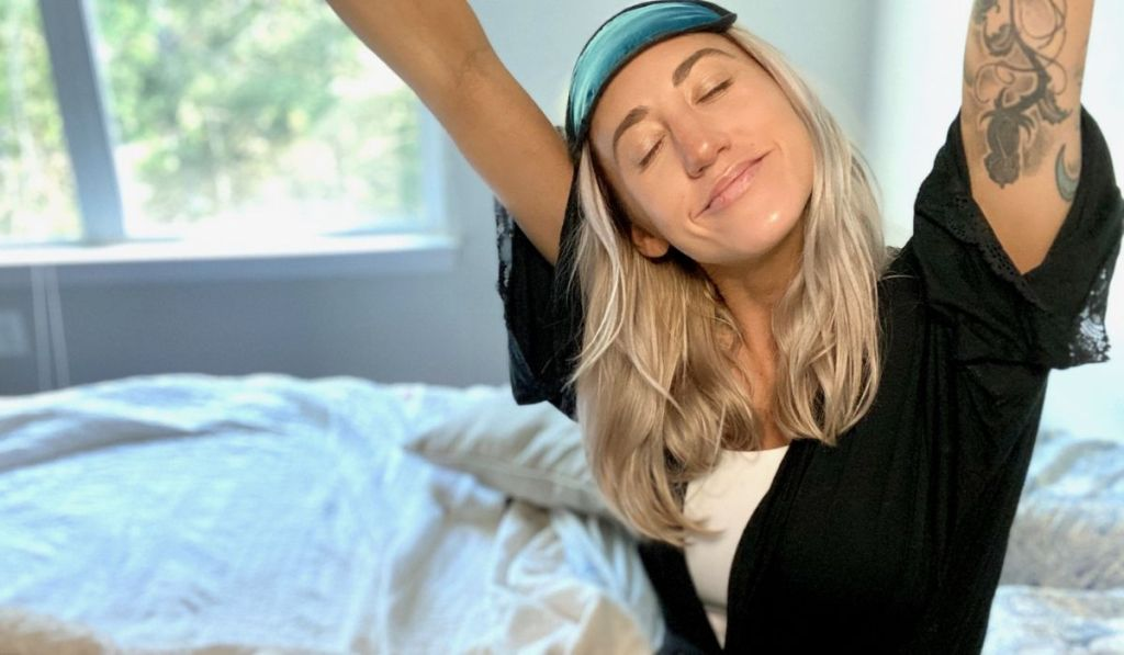 Woman in bed waking up refreshed