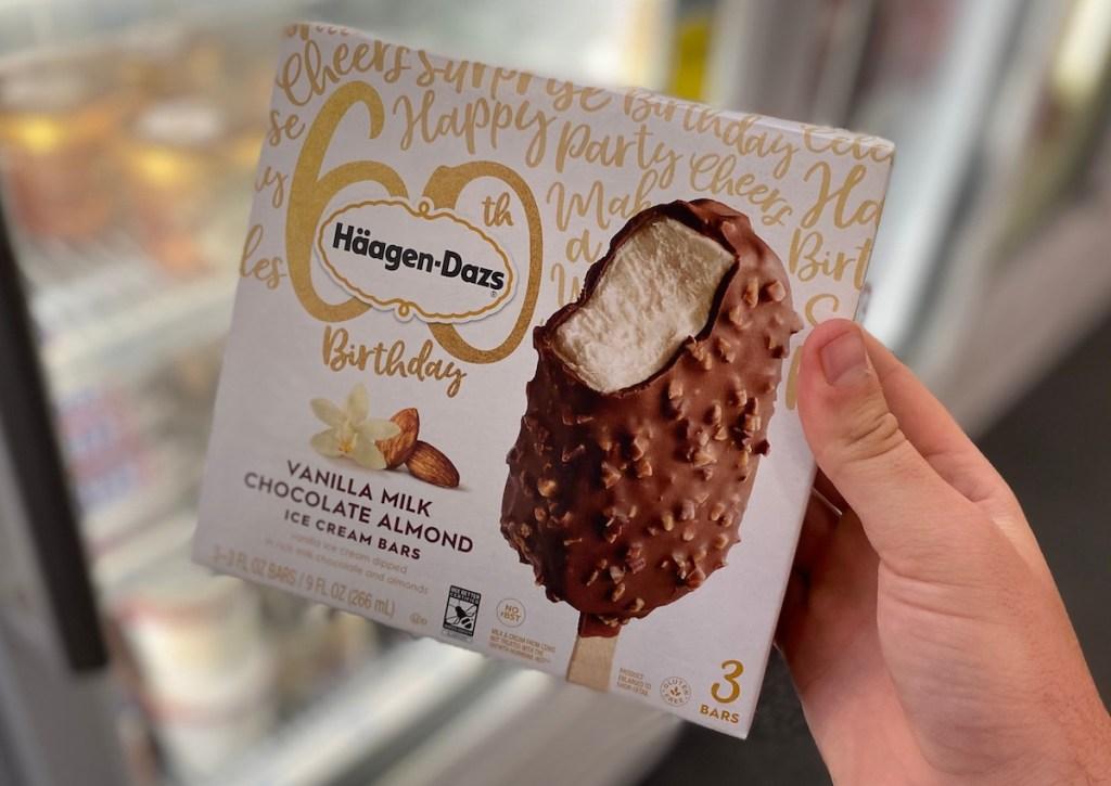 hand holding box of haagen-dazs bars