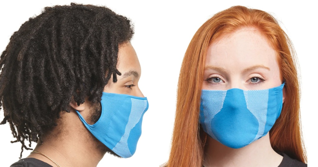 man facing a woman sideways both wearing bright blue face masks