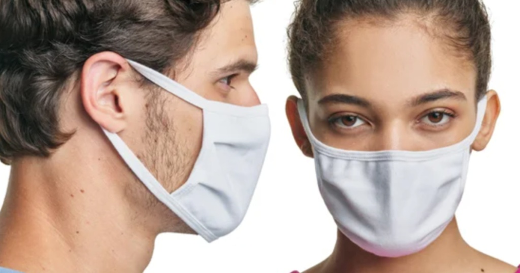 man facing a woman and both wearing white non-medical face masks