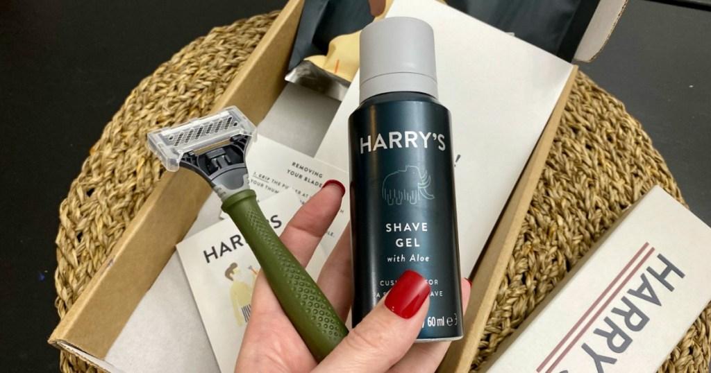 hand holding a razor and Harry's shaving cream