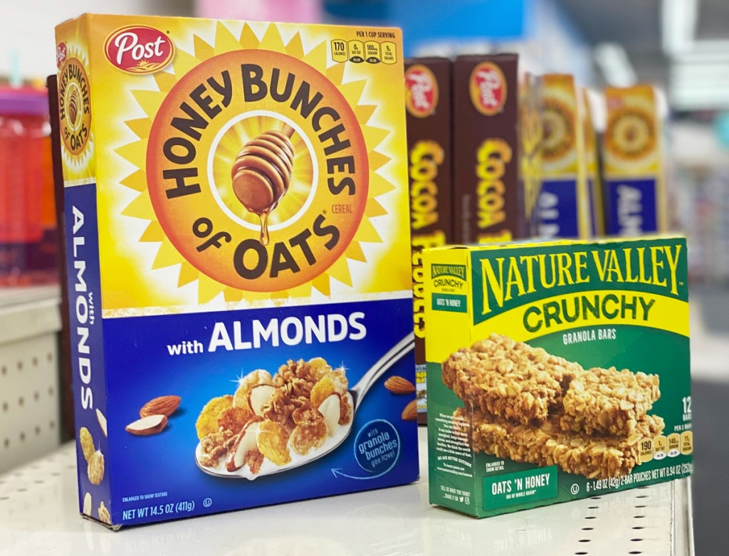 box of honey bunches of oats cereal and box of nature valley cereal bars sitting on store shelf