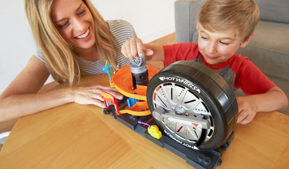 boy and woman playing with a Hot Wheels set
