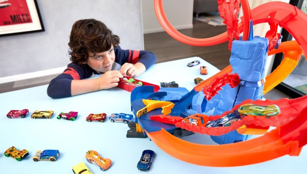 boy playing with a Hot Wheels set