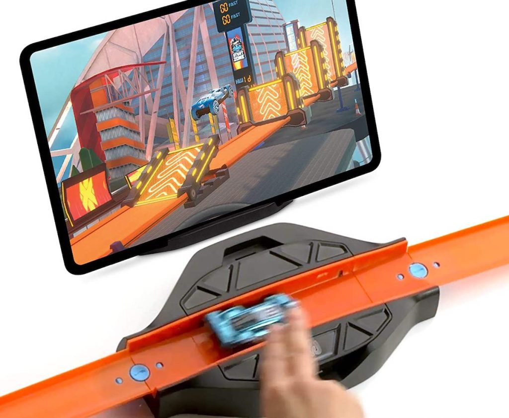 blue car on hot wheels id race portal with app playing on tablet