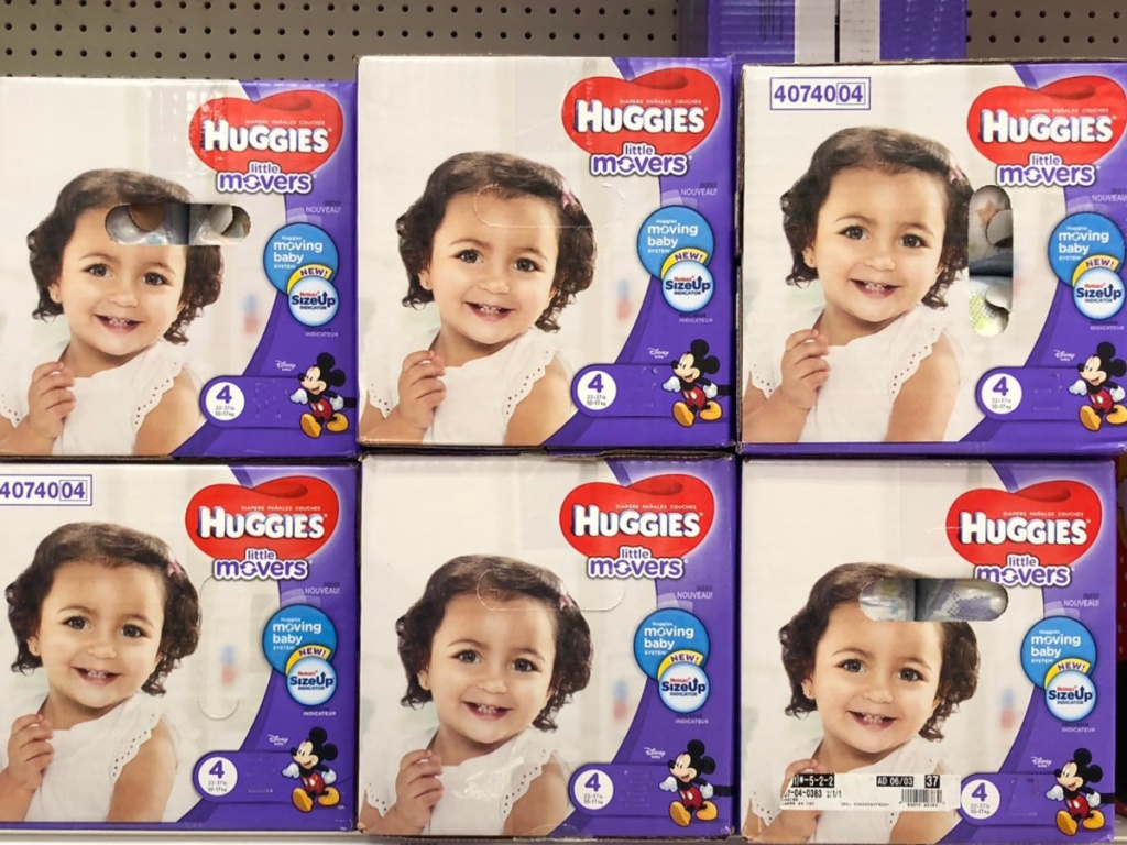 multiple large boxes of diapers on a store shelf