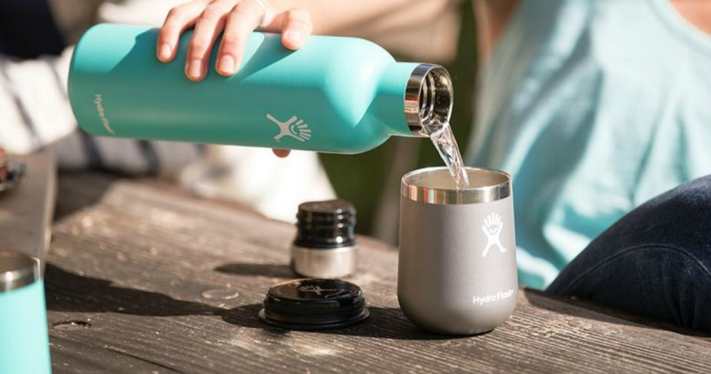 person pouring from wine flask into a Hydro Flask Wine Tumbler