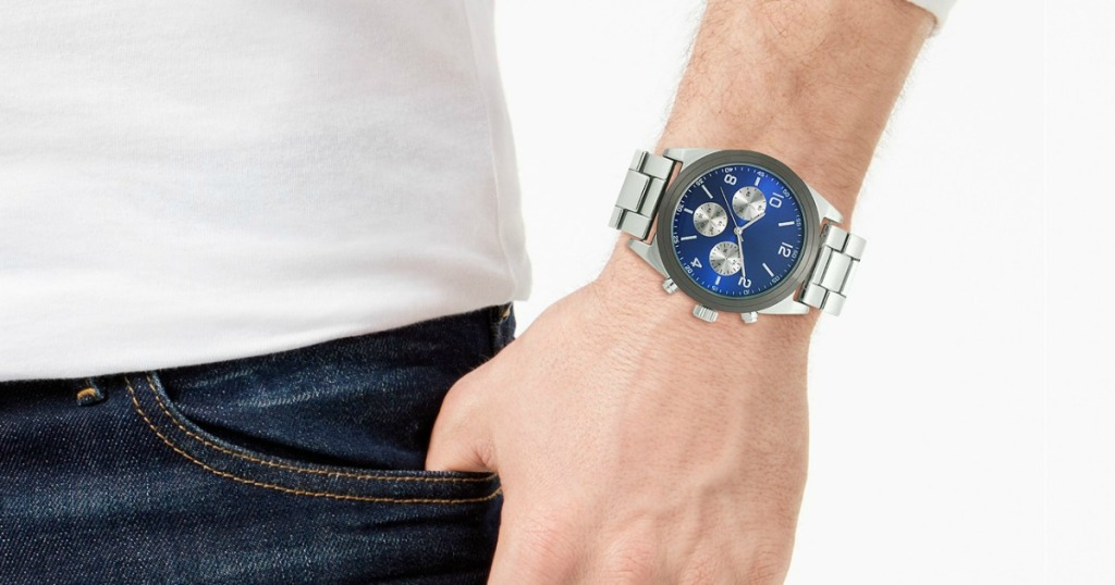 man wearing a watch with hand tucked into pocket