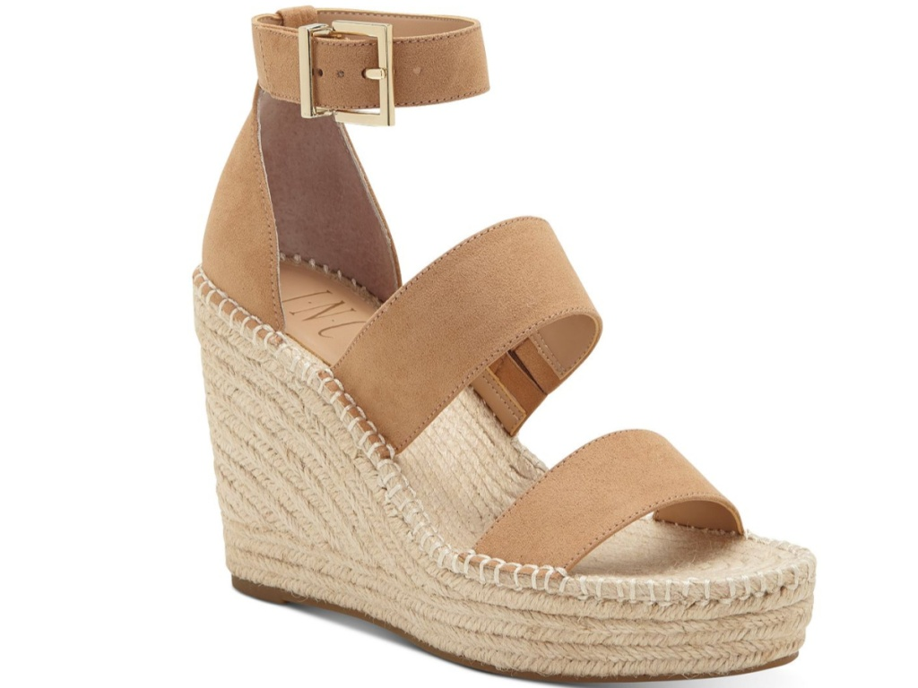 brown open-toed sandal with ankle buckle strap and wedge heel