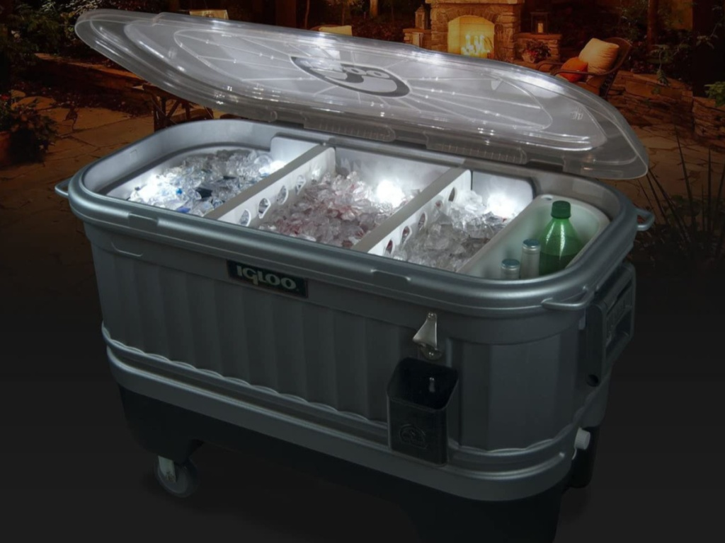 Igloo Cooler Bar Cooler on wheels lit up in the dark with drinks inside