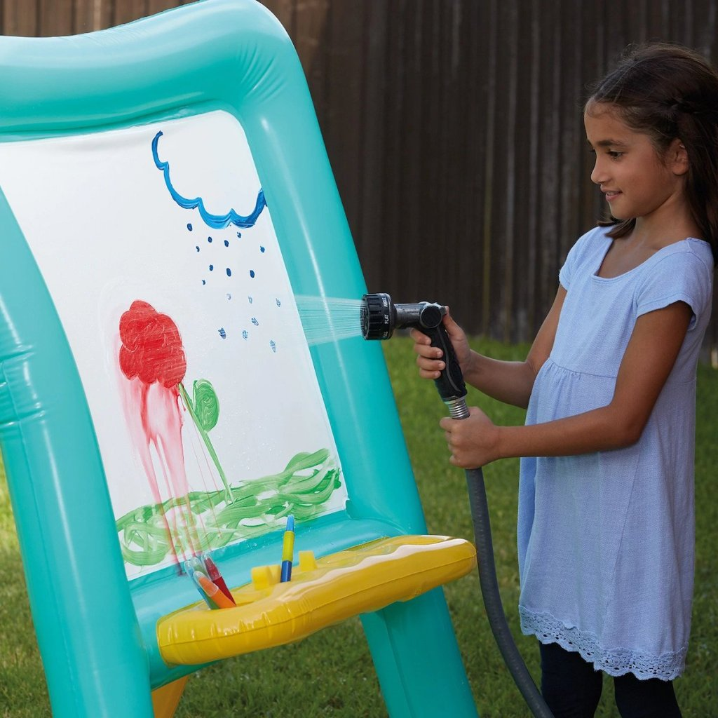 gilr hosing off paint on Inflatable Easel by Creatology