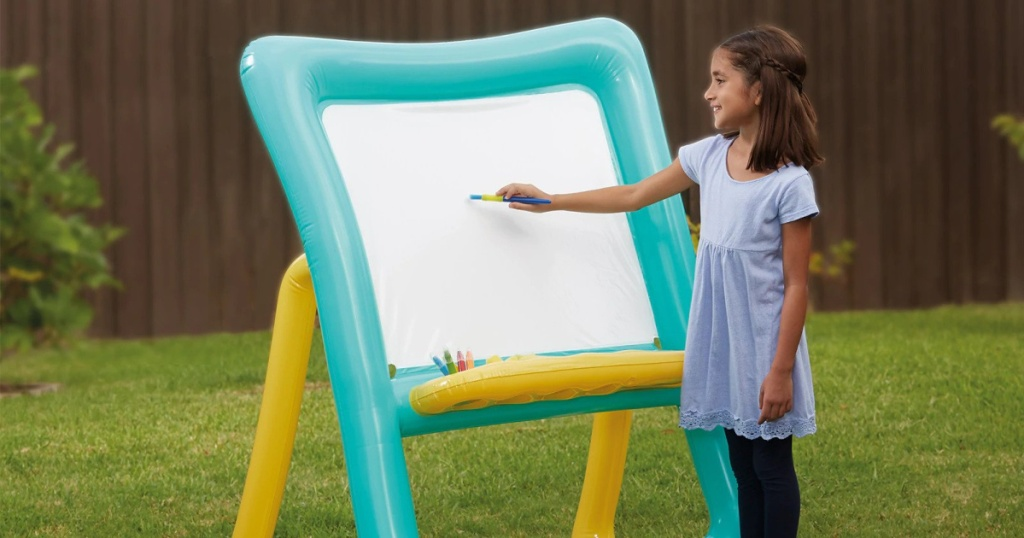 girl painting on Inflatable Easel by Creatology outside