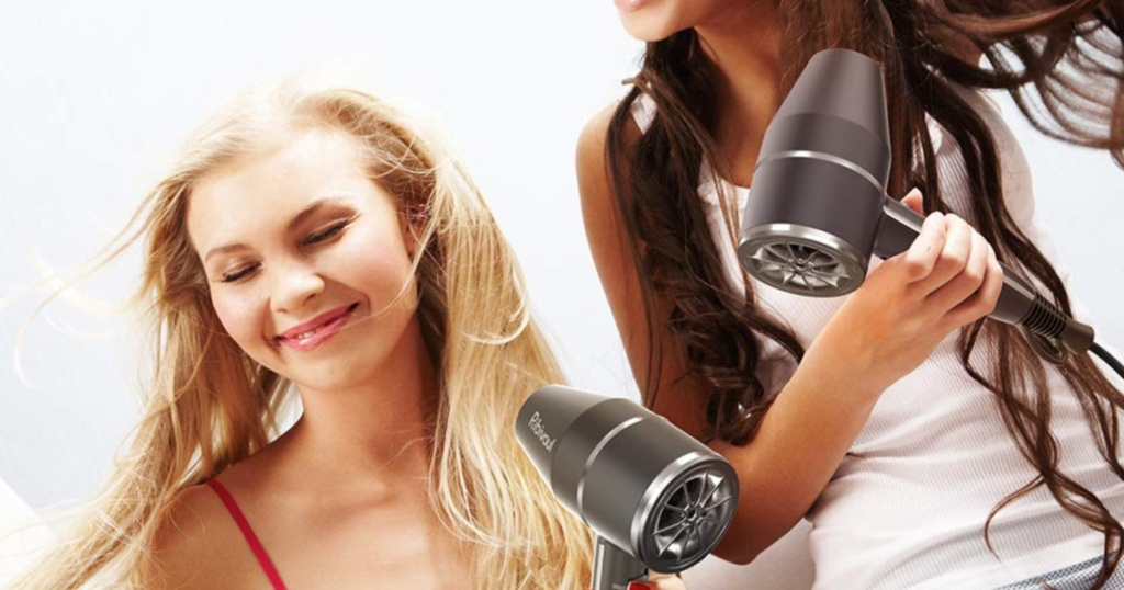 two girls blow drying their hair
