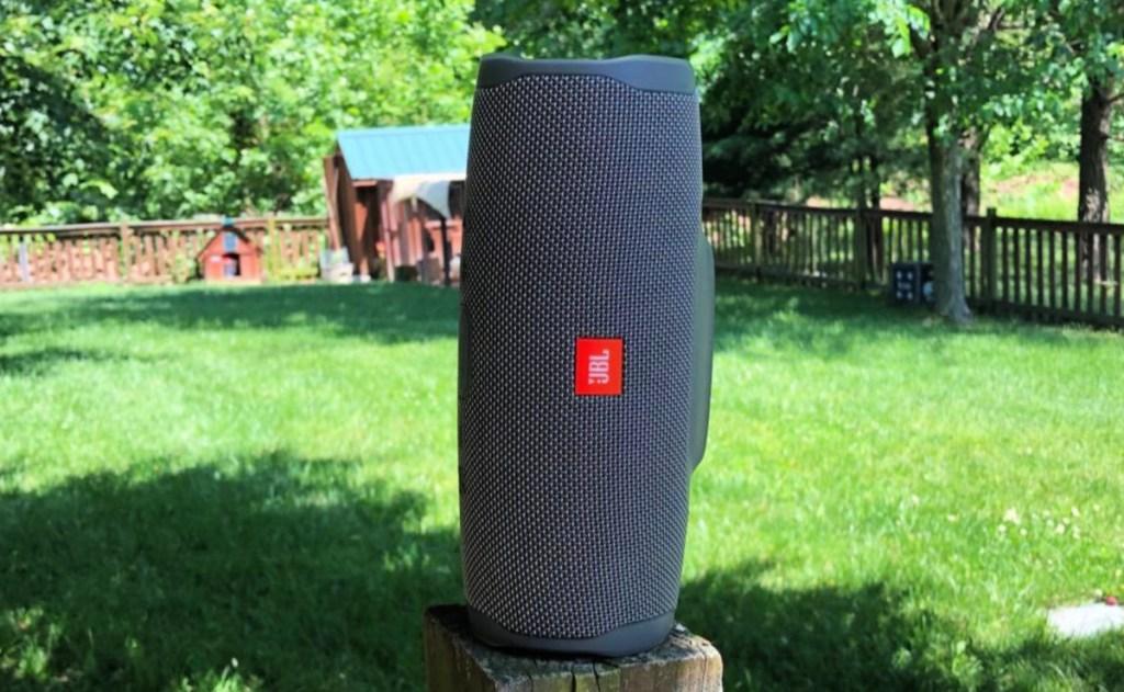 JBL Charge 4 Portable Bluetooth Speaker (Gray) in backyard