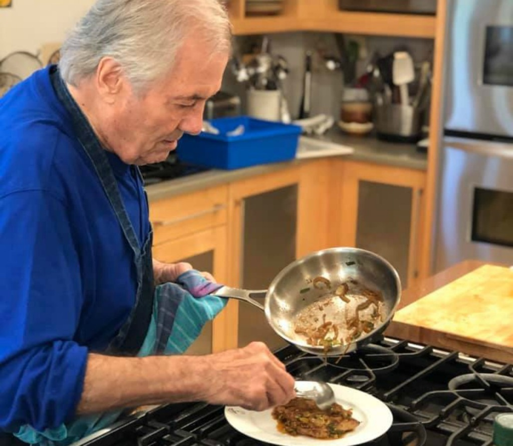 Jacques Pépin topping meat with cooked onions